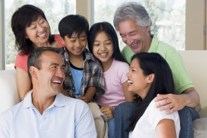 Extended family in living room smiling