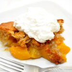 Serving of Peach Cobbler on a White Plate