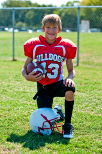 Portrait of a happy youth football player