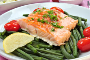 grilled salmon with organic beans on a plate