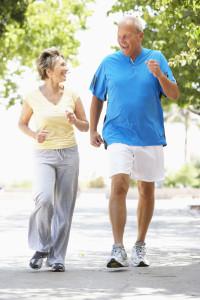 Senior Couple Jogging In Park