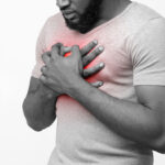 Black young man suffering from acid reflux or heartburn