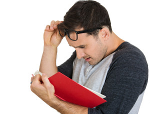 Man having difficulties reading because of vision problems