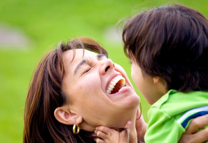 mother and son having fun outdoors in a park