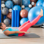 Ab exercise woman swiss ball leg lifts Pilates