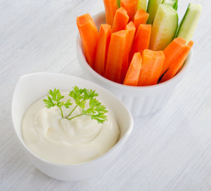 Fresh vegetables with dip. Selective focus